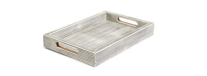Holt Renfrew image of MELA ARTISANS. Artisan-made large decorative tray in pinstripe. $195. SHOP MELA ARTISANS