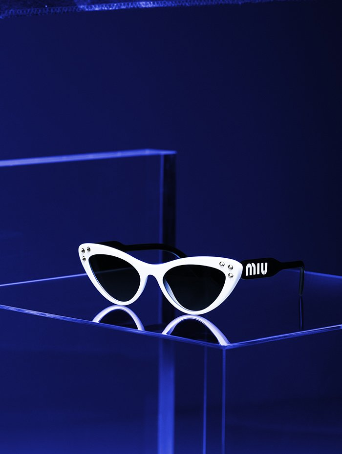 Holt Renfrew image of Miu Miu Narrow cat eye sunglasses with crystal embellishment in white and black. $480.