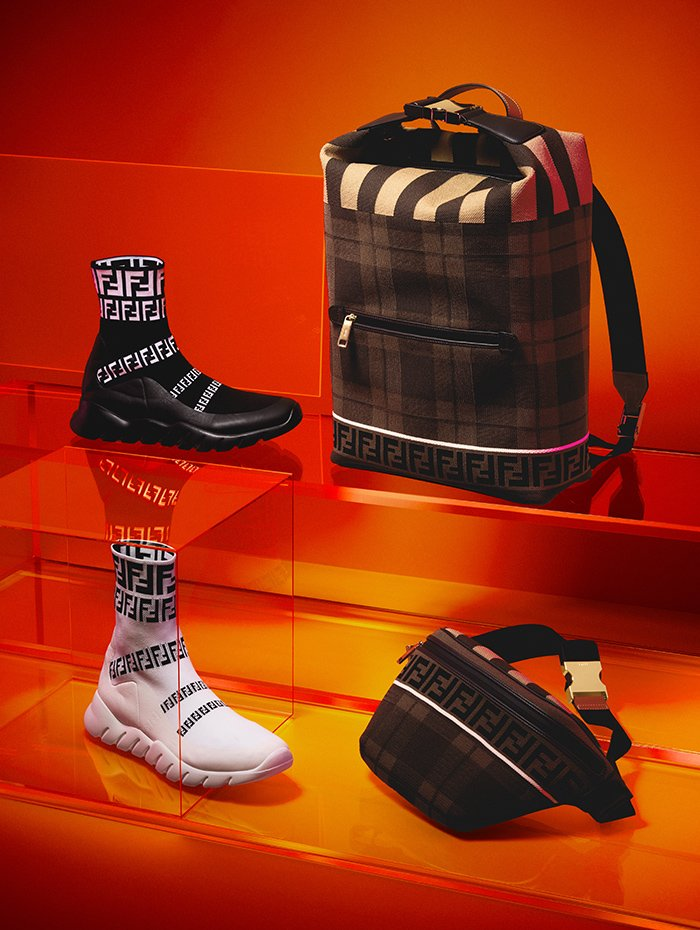 Holt Renfrew Image of Fendi calf leather and polyester sock sneaker with FF detail in black or white. $950 each. Backpack. $2790. Belt bag. $1690. Both in brown FF check.
