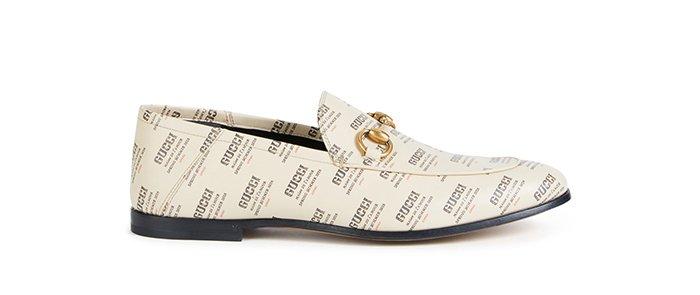 Holt Renfrew image d'un GUCCI flâneurs Brixton en cuir à imprimé Gucci Stamp. 1 170 $. MAGASINER MAINTENANT