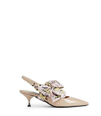 Holt Renfrew image of PRADA Patent Leather Slingback Pumps With Bow. $965. SHOP NOW