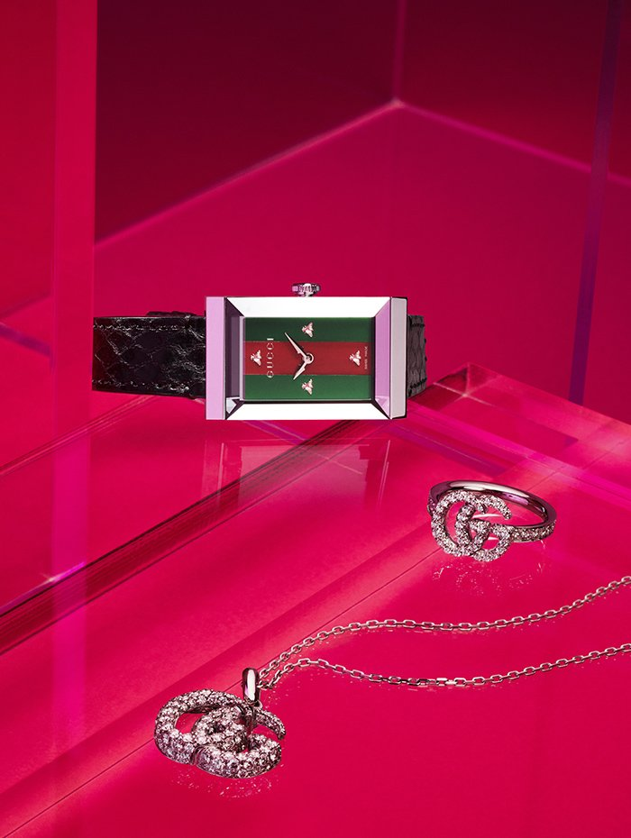 Holt Renfrew image of Gucci G-Frame watch with steel case, mother of pearl dial and ayers strap. $1655. GG Running necklace with diamonds in 18K white gold. $12,130. GG Running ring with diamonds in 18K white gold. $7070.