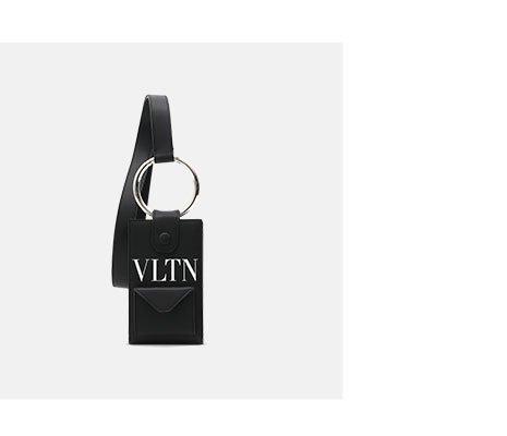 Holt Renfrew Image of VALENTINO. VLTN Logo neck wallet. $900. FIND YOUR STORE