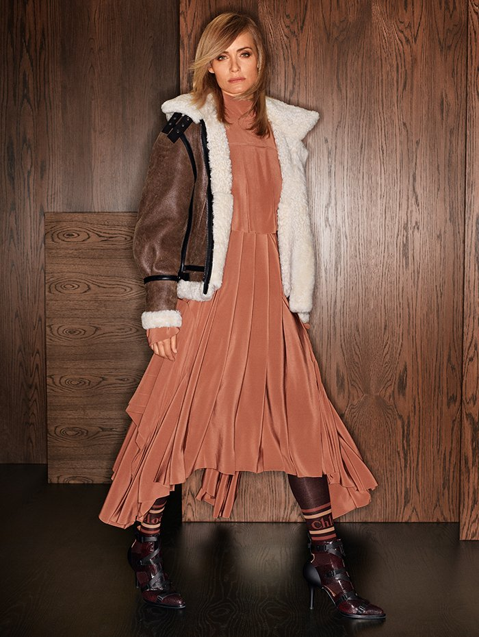 Holt Renfrew Image of CHLOÉ Shearling bomber jacket. $7650. Silk dress with side cutouts. $6250. Calfskin 90 mm Tracy cutout bootie in perfect plum watersnake print. $1725