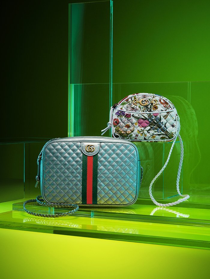 Holt Renfrew image of Gucci Matelassé leather small shoulder bag in silver with metal Double G, web detailing, and braided shoulder strap. $2080. Canvas mini shoulder bag in Flora print with interlocking G, horsebit detailing, and braided leather strap. $1100.