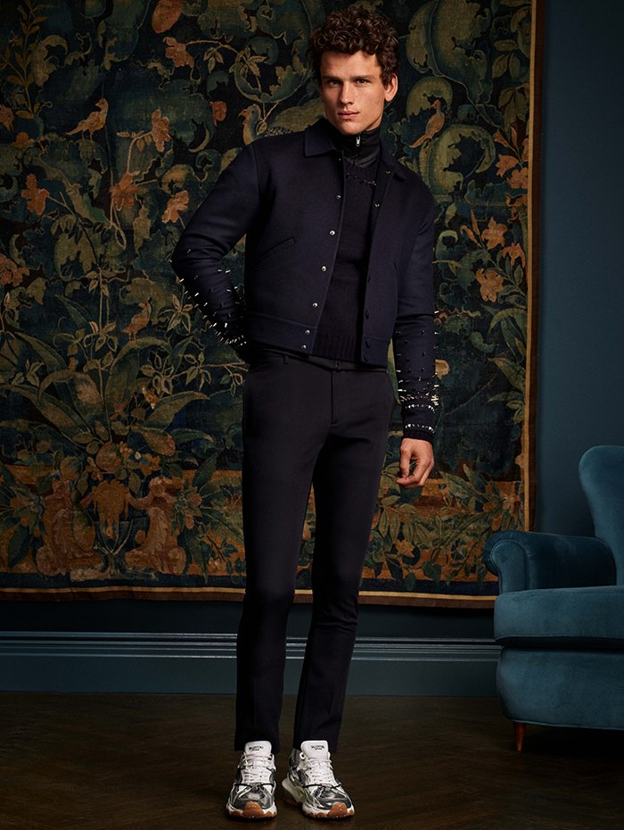 Valentino Wool and cashmere jacket with metal spikes in navy. $3320. Cotton and nylon zip pull with Valentino logo in black. $1280. Cashmere sweater with metal spikes in navy. $1470. Virgin wool slim fit pant in navy. $840. Calf leather Bounce sneaker in silver. $1225.