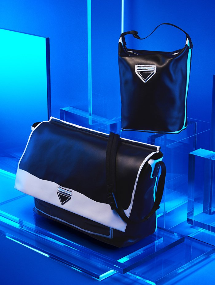 Holt Renfrew Image of PRADA sac à bandoulière Grace Lux. 3 010 $. Sac Grace Lux. 1 270 $. Deux pièces en cuir blanc et noir. Offerts sur demande aux boutiques Prada.