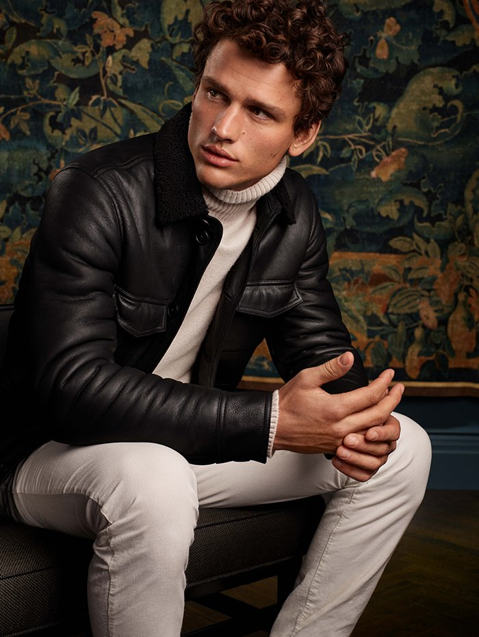 Holt Renfrew Image Of Tomas Maier Exclusively at Holt Renfrew Nappa shearling jacket in black. $5115. Cashmere turtleneck. $1025. Soft cotton sporty pant. $400. Both in chalk.