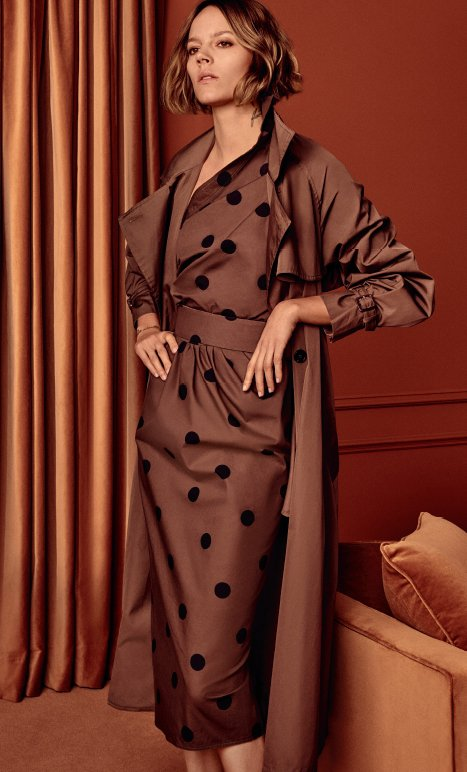 Holt Renfrew image of MAX MARA Albano trench. $2350. Angolo one shoulder dress with black dots. $1145. Both in kaki cotton poplin. FIND YOUR STORE