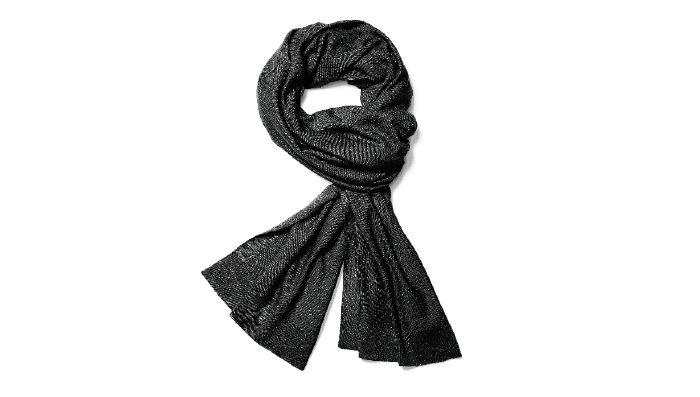 Holt Renfrew image of NAADAM. Chetwyn travel wrap made from ethically sourced Mongolian cashmere. $145. SHOP NAADAM