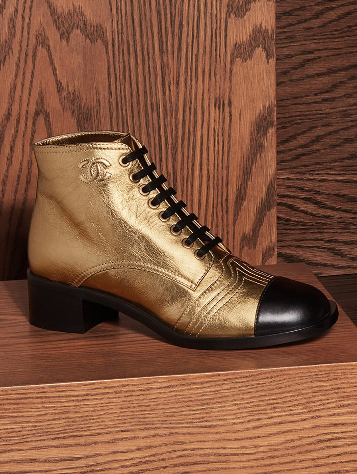 Holt Renfrew Image of CHANEL laminated calfskin lace up boot in gold. Price available upon request.