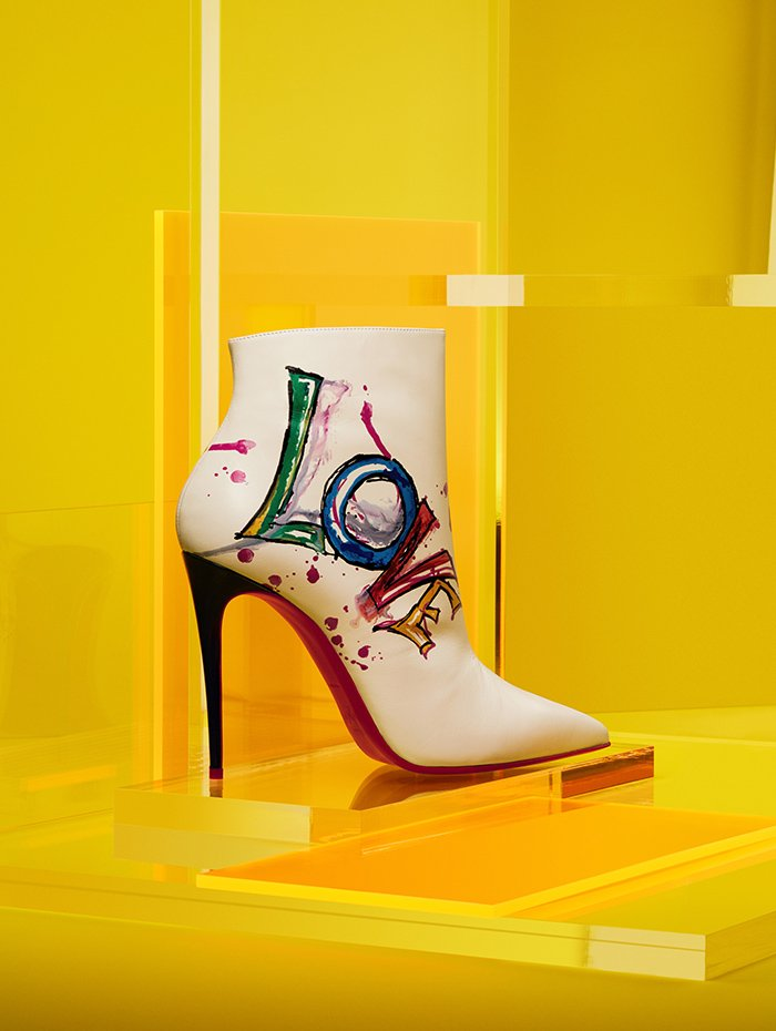 Holt Renfrew image of Christian Louboutin Calf leather 100 mm Boot In Love ankle boot in white. $1745.