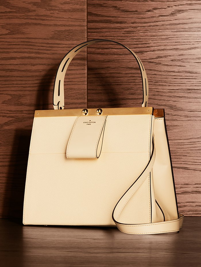 Holt Renfrew Image of LOUIS VUITTON Taiga leather City Frame handbag in banane. $5300.