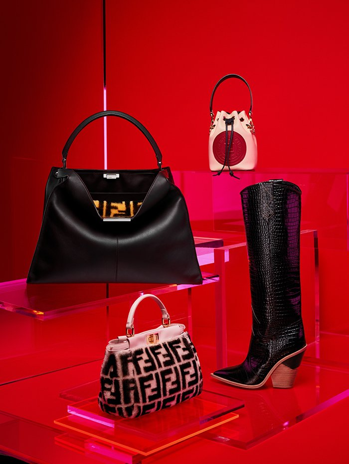 Holt Renfrew image of Fendi Calfskin Peekaboo X-Lite handbag in ebony with shearling macro FF 1974 print interior. $6900. Shearling and nappa leather Peekaboo Mini handbag in light rose macro FF 1974 print. $4900. Liberty calfskin Mon Tresor bag with FF stamp in plaster. $1590. Leather Cut-Walk knee-high boot with embossed crocodile detail in black. $1790.