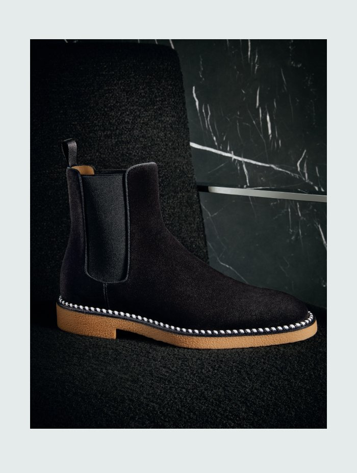 Holt Renfrew Image of CHRISTIAN LOUBOUTIN  Chelsea Crepe wax suede lug sole boot in black. $1410. SHOP NOW.