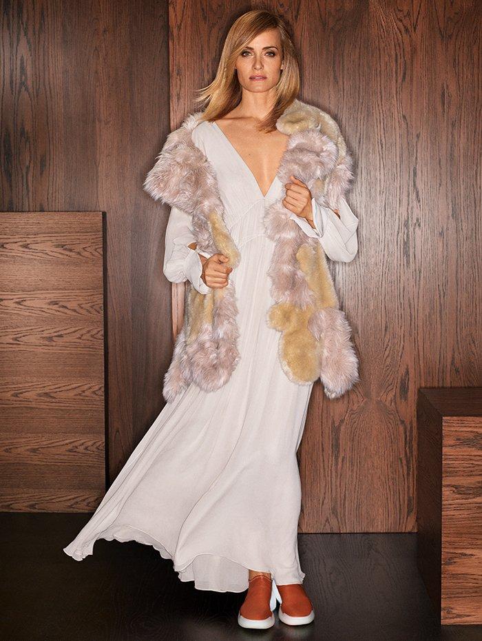 Holt Renfrew Image of STELLA MCCARTNEY Fur-Free-Fur Aurora vest in champagne. $2400. Silk Carleigh dress in bone. $3265. Alter-nappa Loop sneaker in praline. $870.