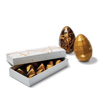 Holt Renfrew image de CXBO Gold edition chocolate pyramids. $56. Ornament eggs. $28.