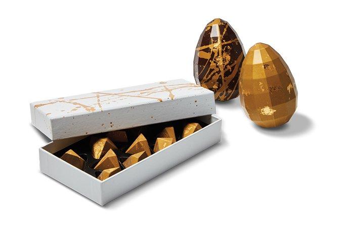 Holt Renfrew image de CXBO Gold edition chocolate pyramids. $56. Ornament eggs. $28.