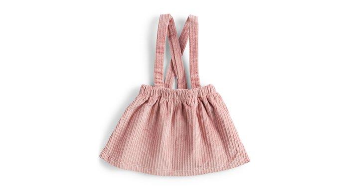 Holt Renfrew image of DOG & DAISY. Ethically-made baby corduroy suspender skirt. $60. SHOP DOG & DAISY
