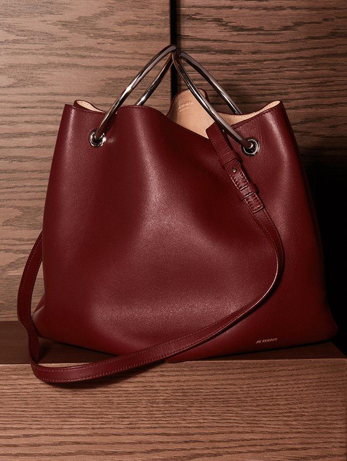 Holt Renfrew Image of JIL SANDER calfskin Loop bucket bag in Bordeaux. $2360. Holts Exclusive.