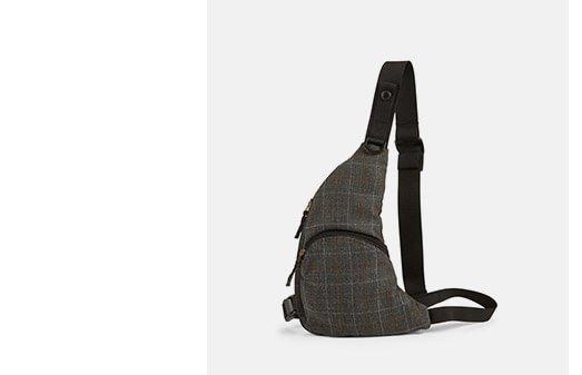 Holt Renfrew image of JUNYA WATANABE. Harness Crossbody Bag In Plaid. SHOP NOW