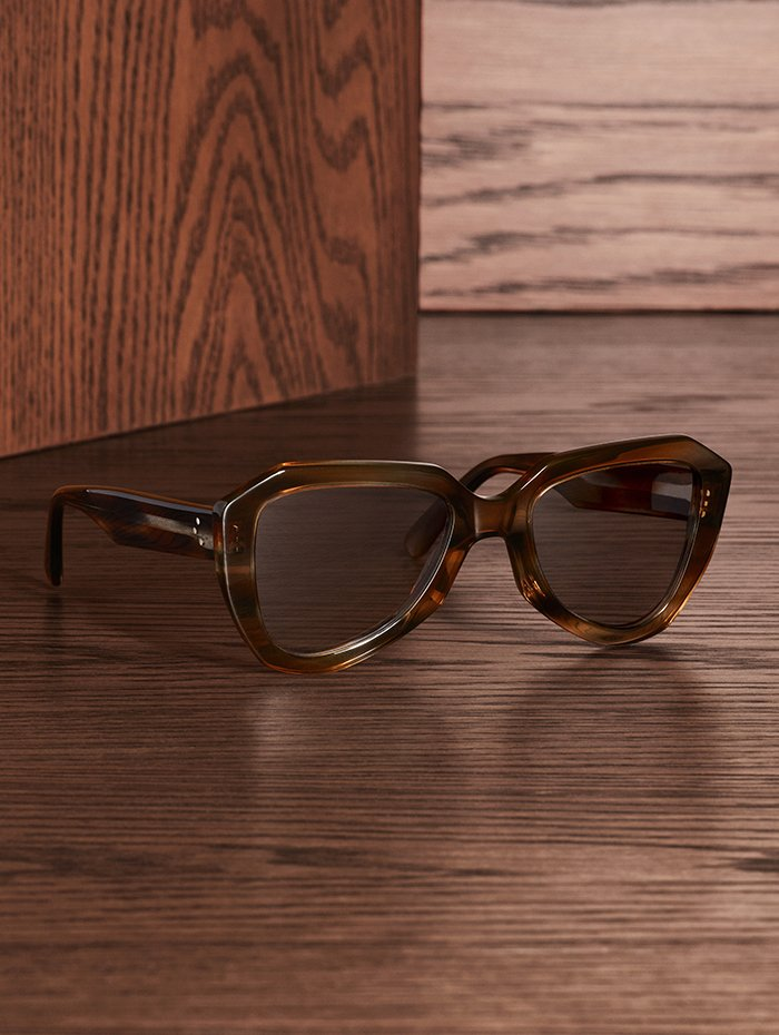 Holt Renfrew Image of CÉLINE sunglasses in blue and brown Havana stripe acetate frame with photochromic lenses that darken in the sun. $620.