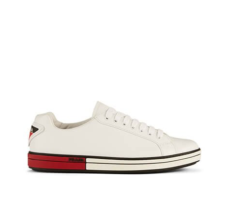 Holt Renfrew image of PRADA LINEA ROSSA Leather Logo Sneakers. $790. SHOP NOW