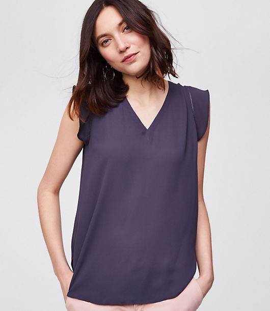 Flutter sleeves are a femme finish for this oh-so-polished and fluid shell. V-neck. Flutter cap sleeves. Shirred beneath back yoke. Shirttail hem.