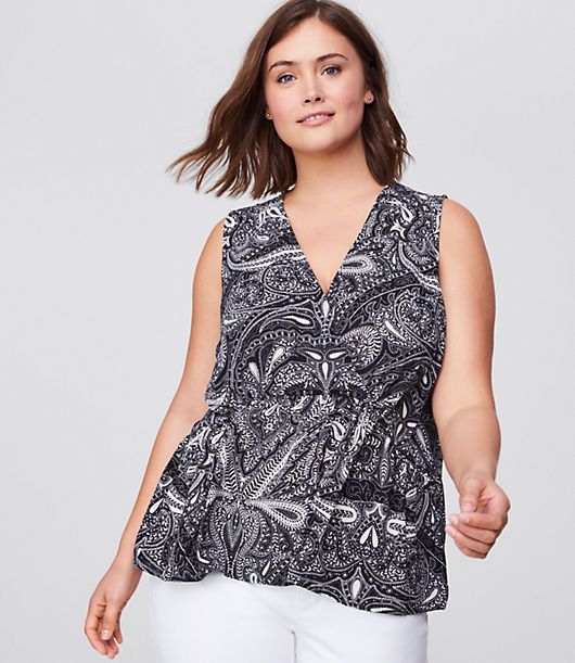 Styled with darts at the bust for a super flattering fit! That's a wrap - consider your everyday style needs met with this flowy shell, made extra flattering with a wrap-effect front and soft knit back. Crossover V-neck. Shirred peplum hem.