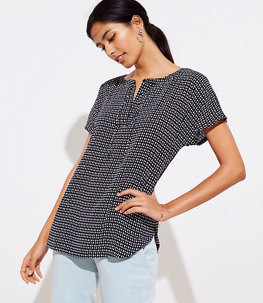 Spliced with a fluid woven front - and soft knit sleeves and back - this tee has just the right amount of modern-cool allure. Split neck with ties. Short dolman sleeves. Hi-lo shirttail hem.