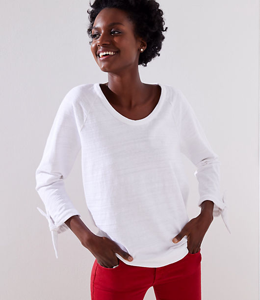 Tie cuffs wrap up this sporty-cool cotton sweatshirt with a feminine twist. Scoop neck. 3/4 sleeves.