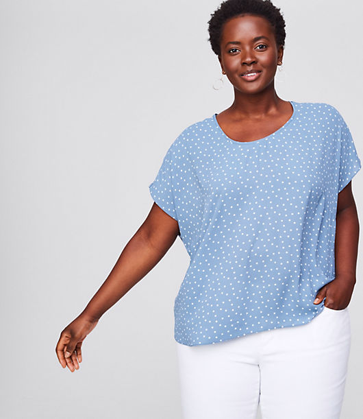Spliced with a fluid woven front - and soft knit sleeves and back - this tee has just the right amount of modern-cool allure. Round neck. Short dolman sleeves. Hi-lo shirttail hem.