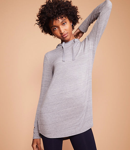 Topped with a drapey drawstring hood, this supersoft and stretchy jersey top is an endlessly versatile (and flattering) have-to-have. Long sleeves. Shirttail hem.