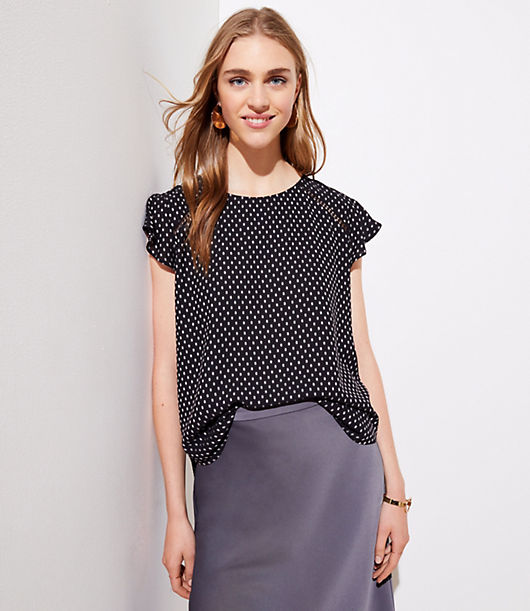 This polished top is a spot on flirt - with flutter sleeves, delicate cutouts and back ties. Round neck. Cap sleeves. V-back with ties. Hi-lo shirttail hem.