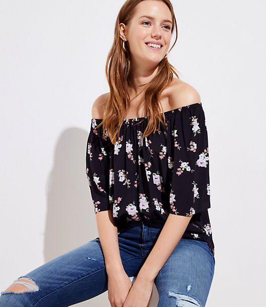 Warm-weather dressing is but a dream with this flowy top, styled with an elasticized neckline you can wear off the shoulder for two looks in one. Flared short sleeves. Side slits.