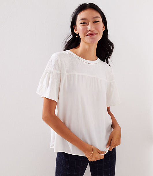 This airy top flows from a dreamy floral embroidered yoke and a delicate cutout neckline. Round neck. Flared short sleeves. Back button keyhole.