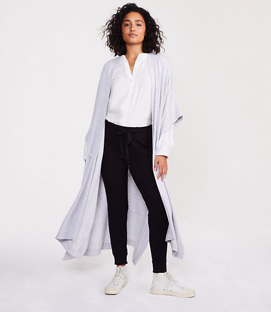 This is the fabric that started it all. Feels like the most luxurious cashmere combined with your favorite sweatshirt. Wrap yourself up and say, ahhhhh. Short dolman sleeves. Open front. Patch pockets. Side slits. 44inch long.