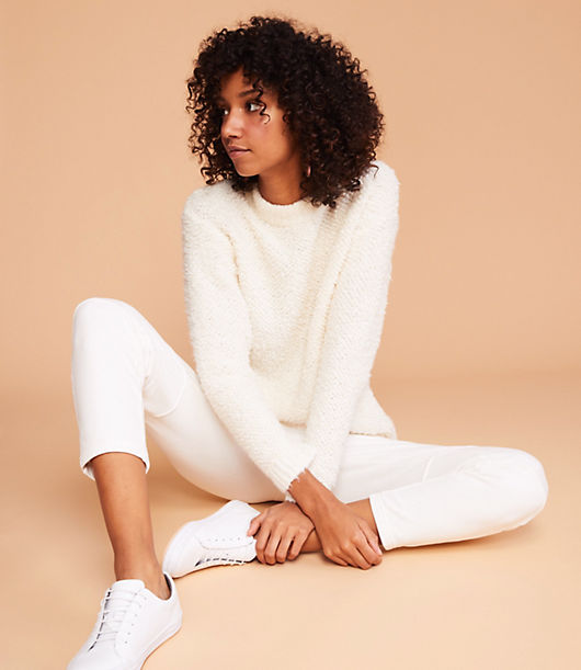 In extra plush textured yarn, this endlessly soft sweater is always up for a cuddle. Crew neck. Long sleeves.