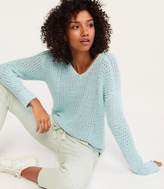 Multidirectional stitching is an unexpected twist for this extra cozy textured knit. V-neck. Long sleeves.