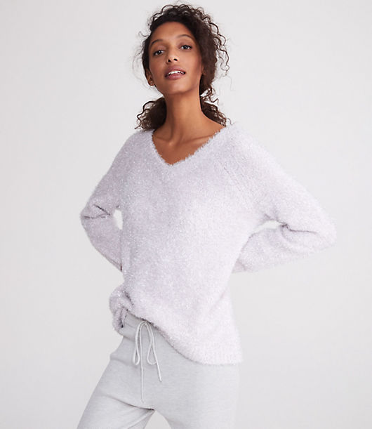 Be frosty in the best way with this shimmery and fuzzy cozy knit - it's always down to glow. V-neck. Long sleeves.