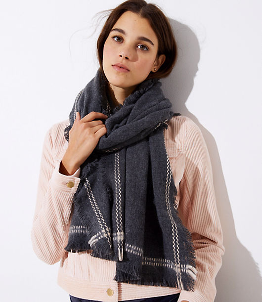 In a chic shade with a stitched border, this soft scarf is an effortlessly stylish partner to any outfit. 24inch x 78 1/2.inch