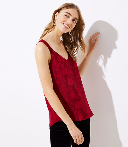 Effortless, irresistible, and always polished, this flowy cami is perfection alone - or layered. V-neck. Wide straps go into racerback. Shirttail hem. Lined.