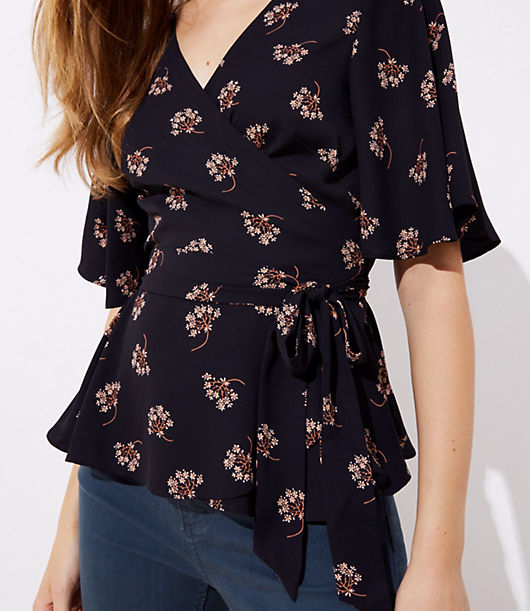 This romantic wrap blouse proves the flattering appeal of a tied waist (with a hint of flair from its hem, too). V-neck. Flutter half sleeves. Waist ties.