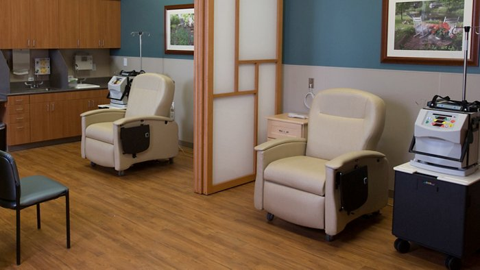 Two beige Champion Chair recliners in a healthcare facility
