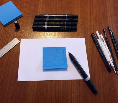 art-supplies-surrounding-start-of-blue-shoe-drawing_bp3p.jpg