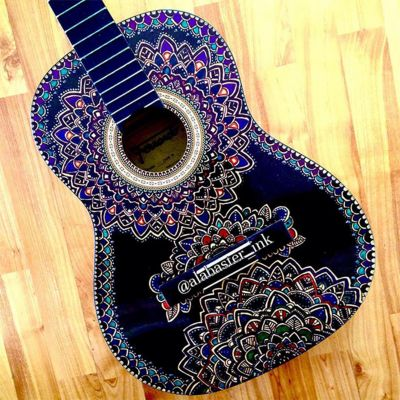blue-guitar-covered-in-sharpie-designs.jpg