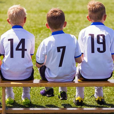 boys-sitting-on-soccer-bench.jpg