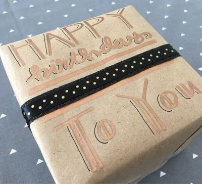 brown-wrapping-paper-decorated-with-sharpie-metallic.jpg