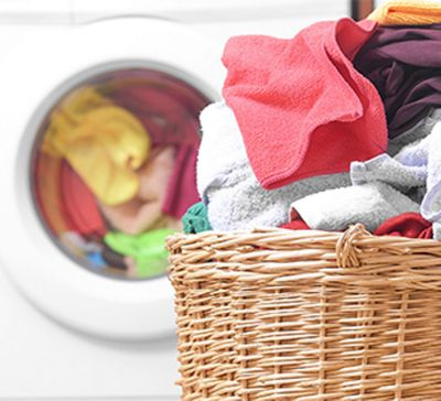 full-laundry-basket-in-front-of-washer.jpg