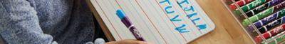 girl-writing-alphabet-on-lined-whiteboard_bp1d.jpg